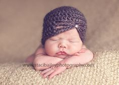I love this little knit hat because it is on trend for newborn shoots but different than the ones we see often!