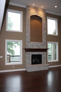 Terrific Pics two story Fireplace Remodel Thoughts Stone fireplace, this is it! the cut out same color as the walls! want darker stone tho Stone Veneer Fireplace, Stone Fireplace Makeover, Stone Fireplace Surround, Stone Fireplace Mantel, Stacked Stone Fireplaces, Family Room Fireplace, Rock Fireplaces, Fireplace Design, Indoor Fireplaces