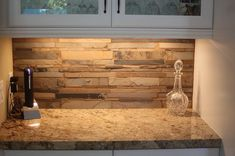 Granite counters with stacked stone backsplash.