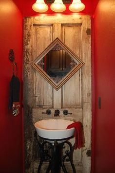 vanity --- old door with mirror - Love this for my country house.