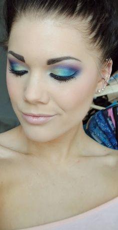 The gorgeous Linda Hallberg, amazing makeup artist. Peacock colored eyeshadow.