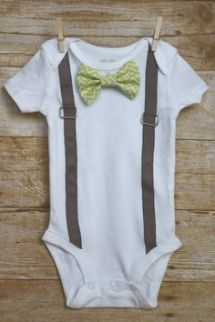 This adorable onesie is perfect for your little ladies man. The onesie comes with two different bowties that attach with snaps so you can mix and match to create the perfect look each day. The suspenders are sewn down keeping the buckle safe and secure. I use Carters onesies, the sizing is as follows.  Newborn: Up to 21.5 inches, 5 - 8 lbs 3 Month: 21.5 - 24 inches, 8 - 12.5 lbs 6 Month: 24 - 26.5 inches, 12.5 - 16.5 lbs 9 Month: 26.5 - 28.5 inches, 16.5 - 20.5 lbs 12 Month: 28.5 - 30.5…