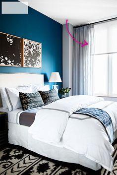 Domino Homeware apartment - deep blue walls, bed linens, curtains