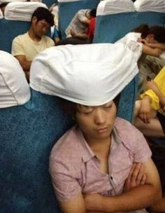 How to sleep on a plane LOL....Don't need to bring along that inflatable travel pillow!