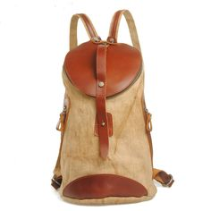 """Using high quality canvas and crazy horse leather production, with mobile phone bags, computer sandwich, Shape is cylindrical. Material: excellent Canvas Antique cow leather from Italy; durable cotton fabric lining; bronze tone hardware Dimensions:  W: 8.66"""" (22 cm)  H: 14.56"""" (37 cm)  D: 6...."""