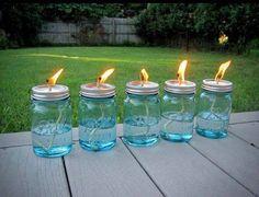Keep bugs away!  Mason jars + cotton string + liquid citronella