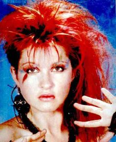 Cyndi Lauper... The girl that just wanted to have fun.. =-)