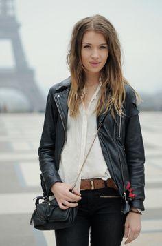 black leather jacket. white button up shirt. black skinny jeans. minimalist.
