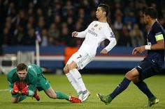 Goalkeeper of PSG Kevin Trapp and Cristiano Ronaldo of Real Madrid in action during the UEFA Champions League match between Paris SaintGermain and...