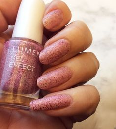 Blogger Funky & fifty upgraded her nude manicure by applying one layer of Lumene Gel Effect Nail Polish shade 60, Frosted berry. Just look at that girly pink sparkle! #nailpolish #lumene