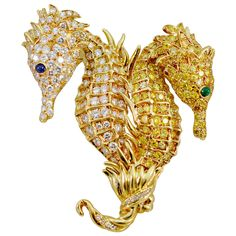 Tiffany & Co.  Diamond Gold Double Seahorse Brooch | From a unique collection of vintage brooches at https://www.1stdibs.com/jewelry/brooches/brooches/