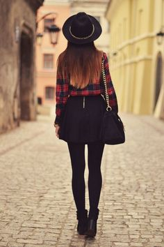 Plaid shirt, black skater skirt and hat.