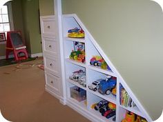 Find this Pin and more on Playroom(s). Storage under stairs ...