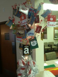 Fundraiser idea - ask local businesses to donate small gift cards to sell @ silent auction and make a tree like this.