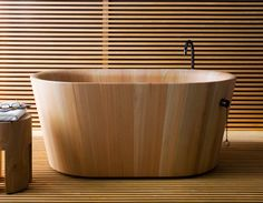 """Co. Design also has some great """"disappearing"""" wood slab sinks, showers and toilets!"""