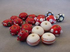 Destash Beads 19 Red lampwork beads 12mm mixed lot of red bumpy glass beads red striped beads destash red lampwork beads by Magicclosetbling on Etsy