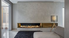 Are you interested in modern fireplaces? Do you want your fireplace to make a real statement in your home? Then take a look at our modern fireplace designs. Suspended Fireplace, Linear Fireplace, Open Fireplace, Fireplace Wall, Living Room With Fireplace, Living Room Decor, Fireplace Ideas, Wall Fireplaces, Corner Fireplaces