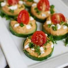 Cucumber Hummus Bites make the perfect finger food and appetizer for your next part or get together. Crisp cucumbers slices are topped with roasted red pepper hummus, tomatoes, feta cheese and fresh parsley. // A Cedar Spoon Appetizer Dips, Healthy Appetizers, Appetizers For Party, Appetizer Recipes, Healthy Snacks, Healthy Recipes, Cucumber Appetizers, Snack Recipes, Canapes Faciles