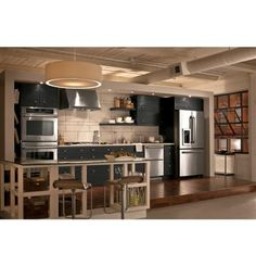 Use open shelving to give your kitchen a spacious feel.
