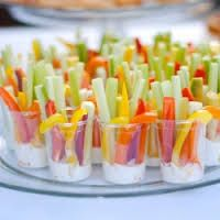 Put ranch dressing in cups. Add slices of carrots, celery , red and green and yellow peppers