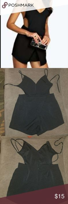 Open Back skort playsuit Never worn   This is an open back skort playsuit. Never worn but really cute for the summer. Boohoo Pants Jumpsuits & Rompers