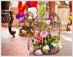 Colorful flowers and vines in a bird cage