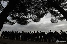 Refugees line-up as they are about to cross Greece's border with FYRO Macedonia,  REUTERS/Yannis Behrakis
