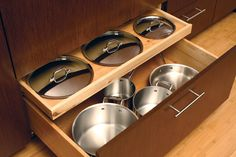 Pot & Pan Sotrage / Lid Storage - A shallow roll-out drawer neatly stores the lids for the pots and pans in the deep drawer below (by Dura Supreme Cabinetry).