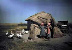 January Hortobбgy National Park, Hungary --- Women stand in front of a primitive straw covered hut --- Image by © Hans Hildenbrand/National Geographic Society/Corbis Old Photos, Vintage Photos, Hut Images, Half The Sky, National Geographic Society, Pattern Images, Great Pictures, World War I, Vintage Colors