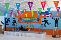 This orange and blue backdrop is perfect for the Cathletics Catholic VBS! Decorate it with the VBS logo, various sports equipment, and the Cathletics pictograms. Vbs Themes, School Themes, Jesus I Need You, Catholic Doctrine, Kid Summer, Action Songs, Greatest Commandment, Vacation Bible School, Prayer Cards
