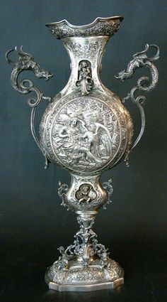 Large Belle Epoque goblet, in the center Leda with the swan and on the opposite side Andromeda with two dragon handgrips, intense baroque de...