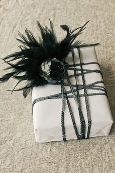 Some feathers will make it a pretty packaging for a gift