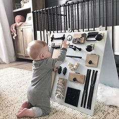 Here's What's Trending in the Nursery this Week - Baby - Baby Diy Diy Busy Board, Busy Board Baby, Toddler Busy Board, Busy Boards For Toddlers, Kids Board, Board Ideas, Montessori Baby, Montessori Bedroom, Baby Lernen