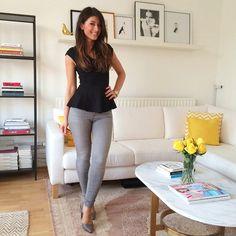Mimi Ikonn | Black peplum top, grey skinny jeans, grey heels