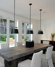 Gorgeous Dining Room Design With Beadboard Walls, Chunky Reclaimed Wood Dining  Table, White Dining Chairs And Black Urban Electric Co.