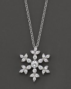 Diamond Snowflake Pendant Necklace in 14 kt. White Gold. Pretty!