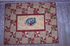 Rose Country Quilts 1st Anniversary Memory quilt.  My husband digitized our logo and embroidered the center.
