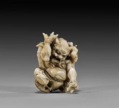 ANTIQUE CARVED IVORY OKIMONO: Seated Oni