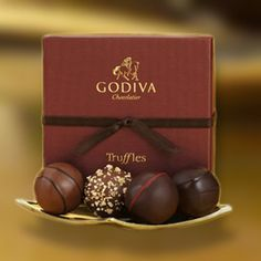 If you sign up for Godiva's rewards program, you get a free piece of chocolate every month!