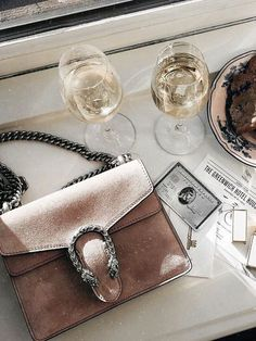 Girls night, gucci bag, wine, and shopping.