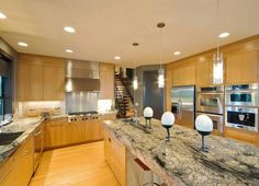 #Kitchen Idea of the Day: Modern Light Wood Kitchen with a dramatic granite countertop.