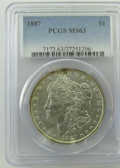 Lot 301 in the 3.18.14 online & live auction! Slabbed 1887-P Morgan Silver Dollar. 26.73g of 90% Silver. Graded by PCGS as MS63. #Coin #Currency #Money #US #POGAuctions