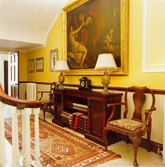 Ardbraccan House, Ireland ~landing adorned with a mahogany period sideboard and matching table lamps and armchairs