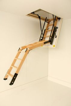 The Skylark Electric Timber Folding Loft Ladder incorporates a timber folding loft ladder with electric motors to allow the trapdoor & ladder to be lowered and raised by a remote control. Folding Attic Stairs, Folding Ladder, Attic Ladder, Loft Ladders, Attic Loft, Home Interior Design, Interior And Exterior, Loft Stairs, Attic Renovation