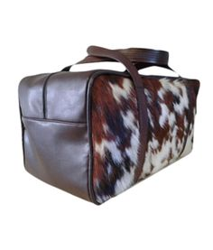 Great Holiday Gift Idea: Cowhide and Leather Duffel Bag in brown and white. Comes in 4 other colors as well. Unique Rustic Chic for the Home...and Her from RusticArtistry.com