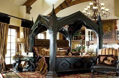 Gothic medieval style bedroom with incredible huge carved four poster bed with rich gold and grey scheme