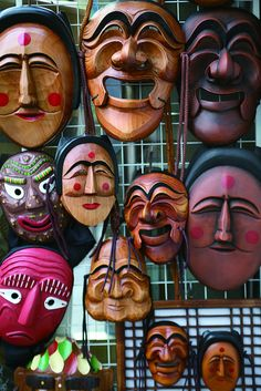 """Masks in Insadong - These wooden masks are used in many types of rituals but are more commonly seen in Korean mask plays called Tal-nori (탈놀이). The word """"tal"""" has the meaning of meeting a misfortune like the words, """"talnatda"""" (something wrong) or """"baetalatda"""" (have a stomachache) and it is said that talnori was played wearing masks shaped like bugaboos to prevent such misfortunes."""