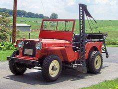 "Love this Jeep Willys CJ-2A ""Universal"" with sickle and dually rear tires."