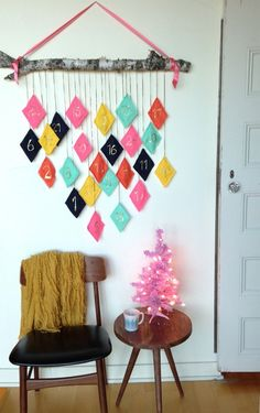 "Melissa over at The Sweet Escape sent us photos of her reusable DIY advent calendar. She says that it's fun & colorful for the kids, but also ""stylish enough for mom"" to happily hang in her space. As a bonus, felt is both affordable, easy to sew, and available in lots of great colors."