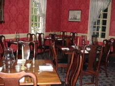 King's Arm tavern, table setting.  Same chairs but different wallpaper.  Another room perhaps?